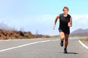 Man running / sprinting on road